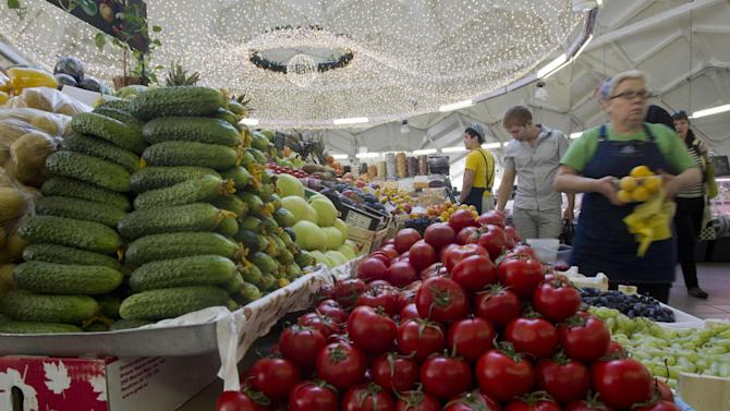 Vendors wait for customers at a Moscow market, Russia, Wednesday, Aug. 22, 2012.On Wednesday Russia joins the World Trade Organization, 19 years after it first began negotiating entry into the group, which restricts import duties and subsidies in an attempt to create a truly level playing field for international trade. While consumers here are expected to benefit from the lower cost of imported goods, some worry that struggling industries long coddled by state subsidies, like agriculture  and the automobile industry, would suffer from foreign competition. (AP Photo/Misha Japaridze)