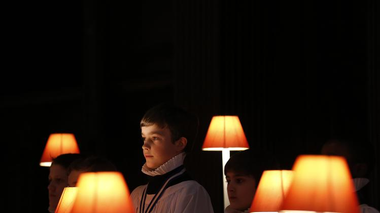 A chorister waits for a cue from his director during rehearsal at St Paul's Cathedral in the City of London
