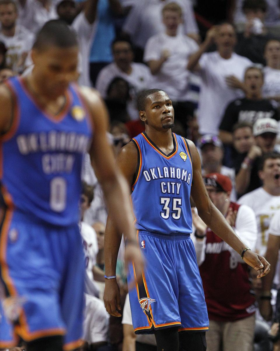 Oklahoma City Thunder point guard Russell Westbrook (0) and small forward Kevin Durant (35) prepare for the next play against the Miami Heat during the first half of Game 4 of the NBA Finals  basketball series, Tuesday, June 19, 2012, in Miami.  (AP Photo/Lynne Sladky)
