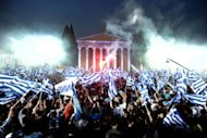 "Supporters of Leader of the Greek conservative party New Democracy Antonis Samaras wave flags during a pre-election speech in Athens. The head of Greece's conservatives said Thursday his party aimed to win enough votes in Sunday's election to govern alone with a ""strong mandate"", despite opinion polls suggesting this will be a tall order"