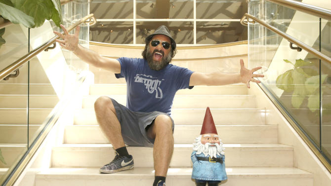Thierry Guetta aka Mr Brainwash and The Travelocity Gnome attend the Go And Smell The Roses at Hard Rock Music Lounge on Friday, April 12 2013 in Palm Springs, California. (Photo by Todd Williamson/Invision for Travelocity/AP Images)
