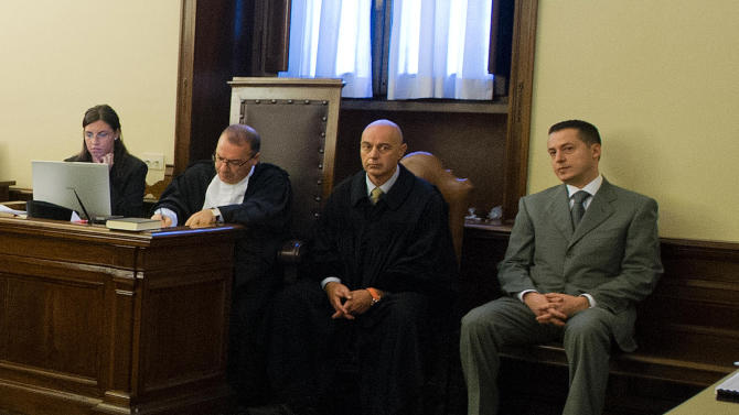 In this photo released by the Vatican paper L'Osservatore Romano, pope's butler Paolo Gabriele, right, sits in the wood-trimmed courtroom of the Vatican tribunal, at the Vatican, Saturday, Sept. 29, 2012. The Vatican opened the public trial Saturday of the pope's butler for allegedly stealing and leaking papal correspondence to a journalist, the most embarrassing scandal of Pope Benedict XVI's papacy. Paolo Gabriele, a 46-year-old father of three, faces up to four years in prison if he is convicted of aggravated theft in the worst security breach in the Vatican's recent history. He has already confessed, saying he acted to shed light on what he called