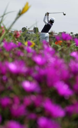 Yani Tseng of Taiwan, hits her tee shot on the fourth hole during the third round of the Kia Classic LPGA golf tournament Saturday, March 24, 2012, in Carlsbad, Calif. (AP Photo/Gregory Bull)