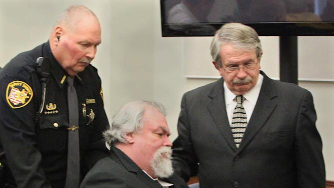 Defense attorney Lawrence J. Whitney, right, accompanies Richard Beasley, center, after the jury recommended death in the courtroom of Summit County Common Pleas Court Judge Lynne Callahan, Wednesday, March 20, 2013, in Akron, Ohio. Beasley, a self-styled street preacher, was convicted of killing three down-and-out men lured by bogus Craigslist job offers. (AP Photo/Akron Beacon Journal, Michael Chritton, Pool)