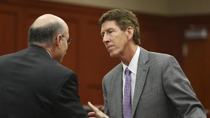 Defense attorney Mark O'Mara, right, speaks with Assistant State Attorney Bernie de la Rionda during George Zimmerman's trial in Seminole circuit court in Sanford, Fla., Friday, June 14, 2013. Zimmerman has been charged with second-degree murder for the 2012 shooting death of Trayvon Martin.(AP Photo/Orlando Sentinel, Gary W. Green,Pool)