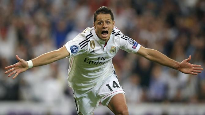 FILE - In this Wednesday April 22, 2015 file photo Real Madrid's Chicharito celebrates scoring his side's first goal during the second leg quarterfinal Champions League soccer match between Real Madrid and Atletico Madrid at Santiago Bernabeu stadium in Madrid, Spain. Real won the match 1-0 to go through to the semifinals. (AP Photo/Paul White, File)
