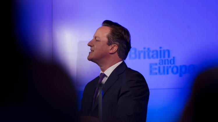 Britain's Prime Minister David Cameron is seen through an autocue and framed by people in the audience as he makes a speech on having a referendum on staying in the European Union in London, Wednesday, Jan. 23, 2013. Cameron said Wednesday he will offer British citizens a vote on whether to leave the European Union if his party wins the next election, a move which could trigger alarm among fellow member states. (AP Photo/Matt Dunham)
