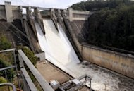 "This file photo shows water spilling from Lake Burragorang, through Warragamba Dam due to heavy rain in the Sydney region, on April 20. An Australian study of ocean salinity over the past 50 years has revealed a ""fingerprint"" showing that climate change has accelerated the rainfall cycle, according to a researcher"
