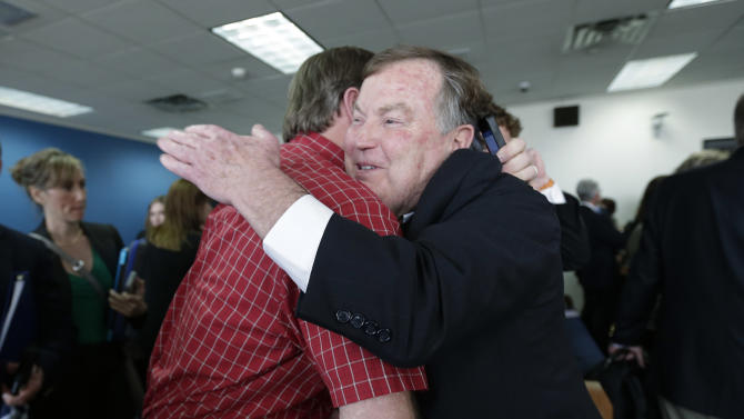 Attorney Rick Gray,right, representing more than 400 districts mostly in poorer areas of the state, is congratulated following a ruling in a consolidated six-lawsuit case contending the school finance system violates the Texas Constitution, Monday, Feb. 4, 2013, in Austin, Texas. State District Judge John Dietz ruled that he system Texas uses to fund public schools violates the state's constitution by not providing enough money to school districts and failing to distribute the money in a fair way. (AP Photo/Eric Gay)