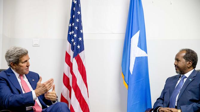 Secretary of State John Kerry meets with President Hassan Sheikh Mohammed, right, at the airport in Mogadishu, Somalia, Tuesday, May 5, 2015, in a show of solidarity with the Somalian government trying to defeat al-Qaida-allied militants and end decades of war in the African country. Kerry is the first secretary of state to visit Somalia. (AP Photo/Andrew Harnik, Pool)