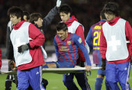 Spain's FC Barcelona forward David Villa, center, is carried on a stretcher after his injury after his goal attempt against Qatar's Al-Sadd Sports Club during the semifinal at the Club World Cup soccer tournament, in Yokohama, near Tokyo, Japan, Thursday, Dec. 15, 2011. (AP Photo/ Shizuo Kambayashi)