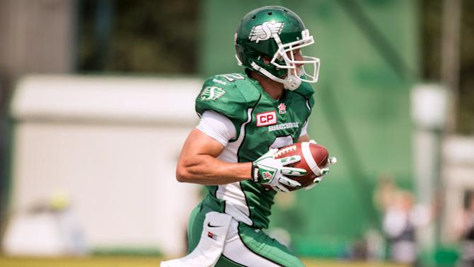 Saskatchewan Roughriders wide receiver Ryan Smith (2) runs the ball into the end zone during the first half of their CFL football game against the Toronto Argonauts in Regina