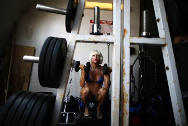 A woman warms up at the Muscle Beach Independence Day bodybuilding contest on Venice Beach in Los Angeles, California