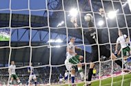 Italian forward Antonio Cassano (not seen) scores against Irish goalkeeper Shay Given during the Euro 2012 football championships match Italy vs Republic of Ireland at the Municipal Stadium in Poznan. Italy qualified for the Euro 2012 quarter-finals beating Ireland 2-0 in their final Group C match here on Monday
