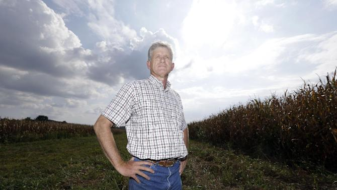 This Aug. 27, 2012 photo shows Mark Cansler in a field on his family farm near Hopkinsville, Ky. Cansler expects visitors to fields like his to observe the next total eclipse of the sun visible from the United States on Aug. 21, 2017. The afternoon event will last longer in a rural stretch near Hopkinsville than any place on the planet. (AP Photo/Mark Humphrey)