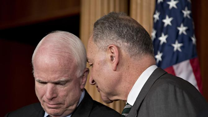 "FILE – In this Jan. 28, 2013, file photo Sen. John McCain, R-Ariz., left, and Sen. Charles Schumer, D-N.Y., right, confer as they and a bipartisan group of other leading senators announce their agreement on the principles of sweeping legislation to rewrite the nation's immigration laws during a news conference at the Capitol in Washington. Eight senators meet in private several times a week, alternating between McCain's and Schumer's offices, and in a capital riven by partisanship and gridlock, they are determined to be the exception and actually get something done. This is immigration reform's ""Gang of Eight"". Others in the group, not shown here, are Sen.s Marco Rubio, R-Fla., Robert Menendez, D-N.J., Lindsey Graham, R–S.C., Dick Durbin, D-Ill., Jeff Flake, R-Ariz., and Michael Bennet, D-Colo. (AP Photo/J. Scott Applewhite, File)"