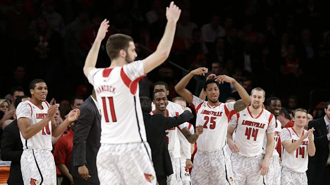 Louisville's Luke Hancock (11) and teammates celebrate late in the second half of an NCAA college basketball championship game against Syracuse at the Big East Conference tournament, Saturday, March 16, 2013, in New York. Louisville won 78-61. (AP Photo/Frank Franklin II)
