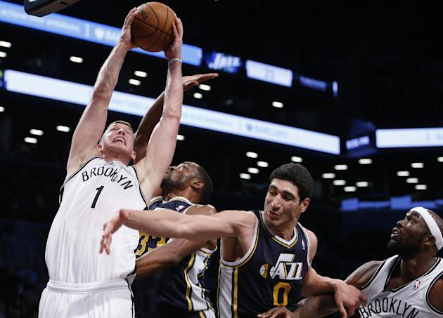 Brooklyn Nets' Mason Plumlee (1) goes to the basket against Utah Jazz's Mike Harris (33) and Enes Kanter (0) as Nets' Reggie Evans watches during an NBA basketball game Tuesday, Nov. 5, 2013, in New Y