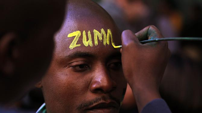 The ruling party African National Congress (ANC) supporter's forehead is painted with the president's name outside the South Gauteng High Court in Johannesburg, South Africa on Thursday May 24, 2012. President Jacob Zuma is asking the High Court to issue an order that display of the now-defaced painting violates his constitutional right to dignity. The gallery and the artist counter that freedom of expression, also protected by the constitution, is at stake. (AP Photo/Themba Hadebe)