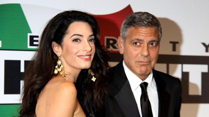 George Clooney and his fiancee Amal Alamuddin at an event in Florence, Italy on September 7, 2014