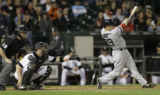 Boston Red Sox's Daniel Nava, right, hits a two-run single against the Chicago White Sox during the ninth inning of a baseball game in Chicago, Wednesday, May 22, 2013