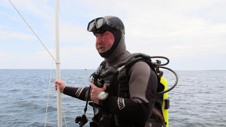 Michel L'Hour, director of France's Department of Underwater Archaeological Research, prepares to dive to what explorers believe may be the site of the long-lost ship the Griffin, Saturday, June 15, 2013 in northern Lake Michigan. Divers began opening an underwater pit Saturday at a remote site in northern Lake Michigan that they say could be the resting place of the Griffin, a ship commanded by the 17th century French explorer La Salle. (AP Photo/John Flesher)