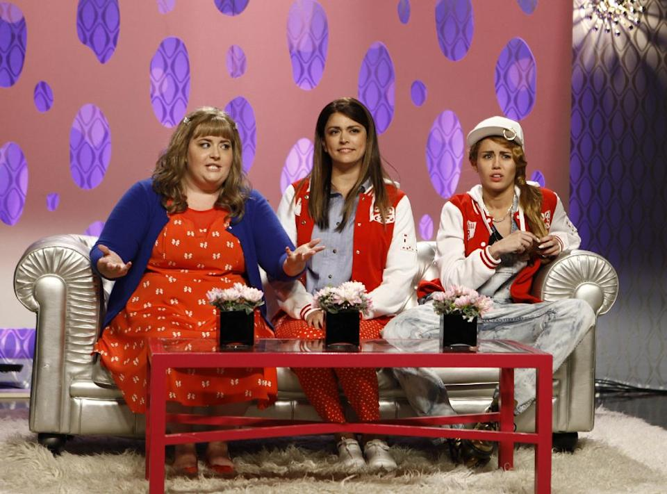 "This Oct. 5, 2013 photo released by NBC shows, from left, Aidy Bryant, Cecily Strong, and guest host Miley Cyrus in a scene from the late-night comedy series ""Saturday Night Live,"" in New York. (AP Photo/NBC, Dana Edelson)"