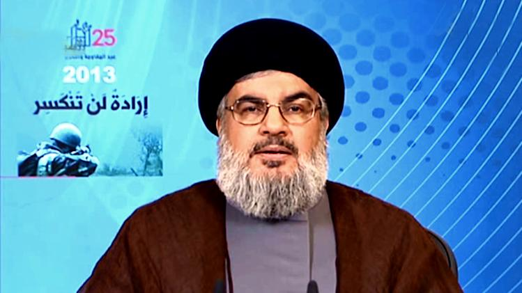 In this photo released by the Syrian official news agency SANA, Hezbollah chief Hassan Nasrallah, gives a televised speech from an unknown location to mark the anniversary of Israel's May 2000 withdrawal from southern Lebanon, Saturday, May 25, 2013. The date is commemorated each year by Hezbollah as a major military victory, however, this year's anniversary comes at a time when Hezbollah is facing growing criticism in Lebanon for its involvement in the Syrian war. (AP Photo/SANA)