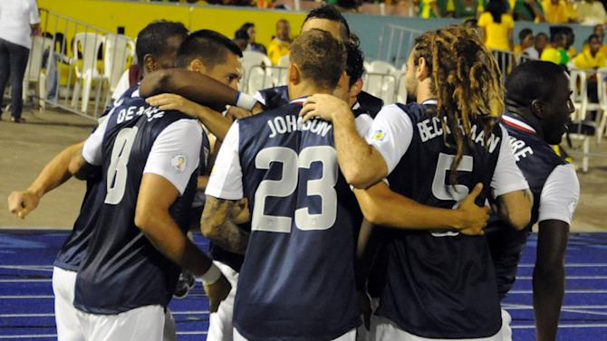 United States' Clint Dempsey, second from left, is congratulated by teammates after scoring against Jamaica in a 2014 World Cup qualifying soccer match in Kingston, Jamaica, Friday, Sept. 7, 2012. Jamaica won 2-1. (AP Photo/Collin Reid)