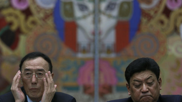 Qiangba Puncog, left, Chairman of the Standing Committee of the People's Congress of the Tibet Autonomous Region and Padma Choling, Tibet government chief attend a meeting held at the Great Hall of the People as part of the 18th Communist Party Congress in Beijing, Friday, Nov. 9, 2012. (AP Photo/Vincent Yu)