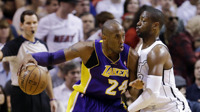 Los Angeles Lakers guard Kobe Bryant (24) drives against Miami Heat guard Dwyane Wade during the first half of an NBA basketball game, Sunday, Feb. 10, 2013, in Miami. (AP Photo/Wilfredo Lee)