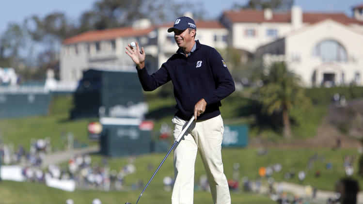 Matt Kuchar waves after making a birdie on the 10th green during the first round of the Northern Trust Open golf tournament at Riviera Country Club in the Pacific Palisades area of Los Angeles Thursday, Feb. 14, 2013. (AP Photo/Reed Saxon)