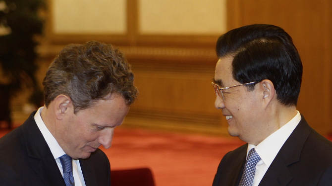 """U.S. Treasury Secretary Timothy Geithner, left, shakes hands with Chinese President Hu Jintao prior to a meeting at the Great Hall of the People in Beijing Friday, May 4, 2012. Geithner told Hu on Friday that China's moves toward a more market-oriented exchange rate are """"very promising"""" and said economic relations are improving despite occasional tensions. (AP Photo/Jason Lee, Pool)"""