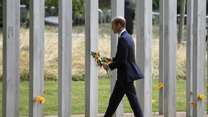 Britain's Prince William pays his respects at the memorial to victims of the July 7, 2005 London bombings