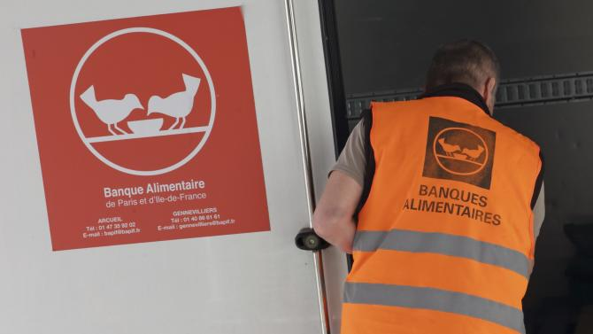 "Guy, a retired train driver, who volunteers at the ""Banques Alimentaires"", loads his truck with goods given by a supermarket to charity organisations in l'Hay-les-Roses"
