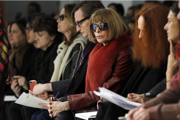 Vogue editor Anna Wintour watches a presentation of the Rodarte Autumn/Winter 2013 collection during New York Fashion Week