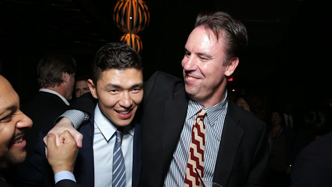 Rick Yune and Millennium Films' Mark Gill at FilmDistrict's Premiere of 'Olympus Has Fallen' hosted by Brioni and Grey Goose at the ArcLight Hollywood, on Monday, March, 18, 2013 in Los Angeles. (Photo by Eric Charbonneau/Invision for FilmDistrict/AP Images)