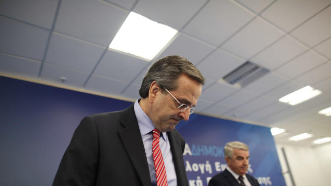 """Greek Prime Minister Antonis Samaras arrives at the headquarters of the conservative """"New Democracy"""" party to address his parliamentary group of lawmakers about the upcoming vote on the new round of austerity measures next week, in Athens, Sun. Nov. 4 2012. Greece's coalition government is struggling to push through a new round of austerity measures that is set to impose new wage, pension, and benefit cuts on a public already plagued by 25 percent unemployment. (AP Photo/Kostas Tsironis)"""