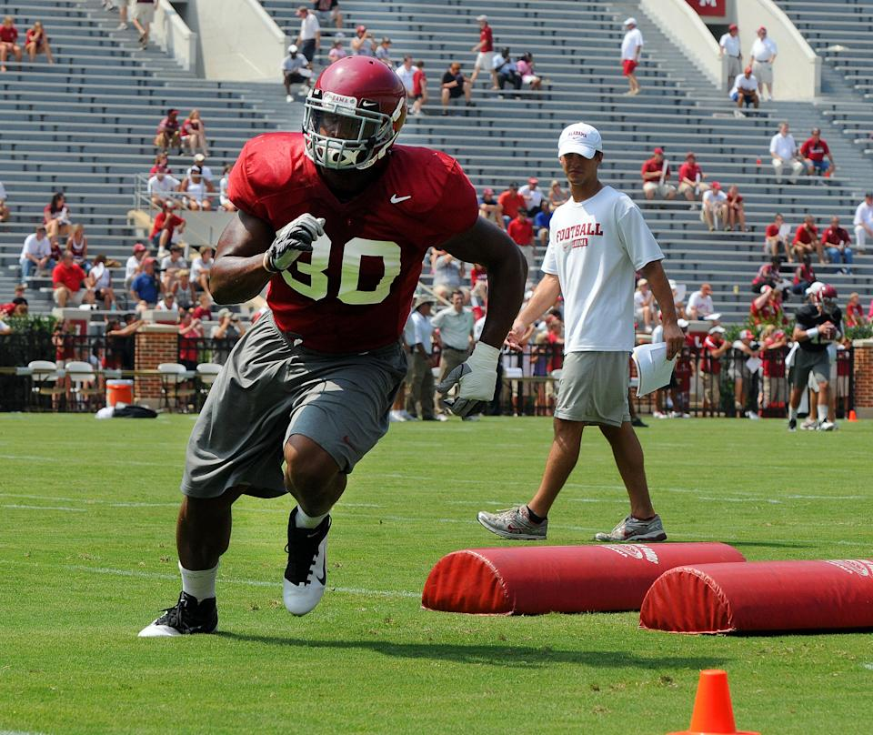 Alabama linebacker Dont'a Hightower (30) works out during preseason NCAA college football drills on Sunday, Aug. 7, 2011, at Bryant-Denny Stadium in Tuscaloosa, Ala. (AP Photo/The Tuscaloosa News, Jason Harless)