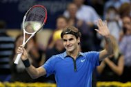 Switzerland's Roger Federer celebrates his victory against France's Benoit Paire at his quarter final match at the Swiss Indoors ATP tennis tournament. Federer won 6-2, 6-2