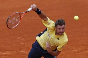 Stanislas Wawrinka of Switzerland serves to Marin Cilic of Croatia during the Monte Carlo Masters in Monaco