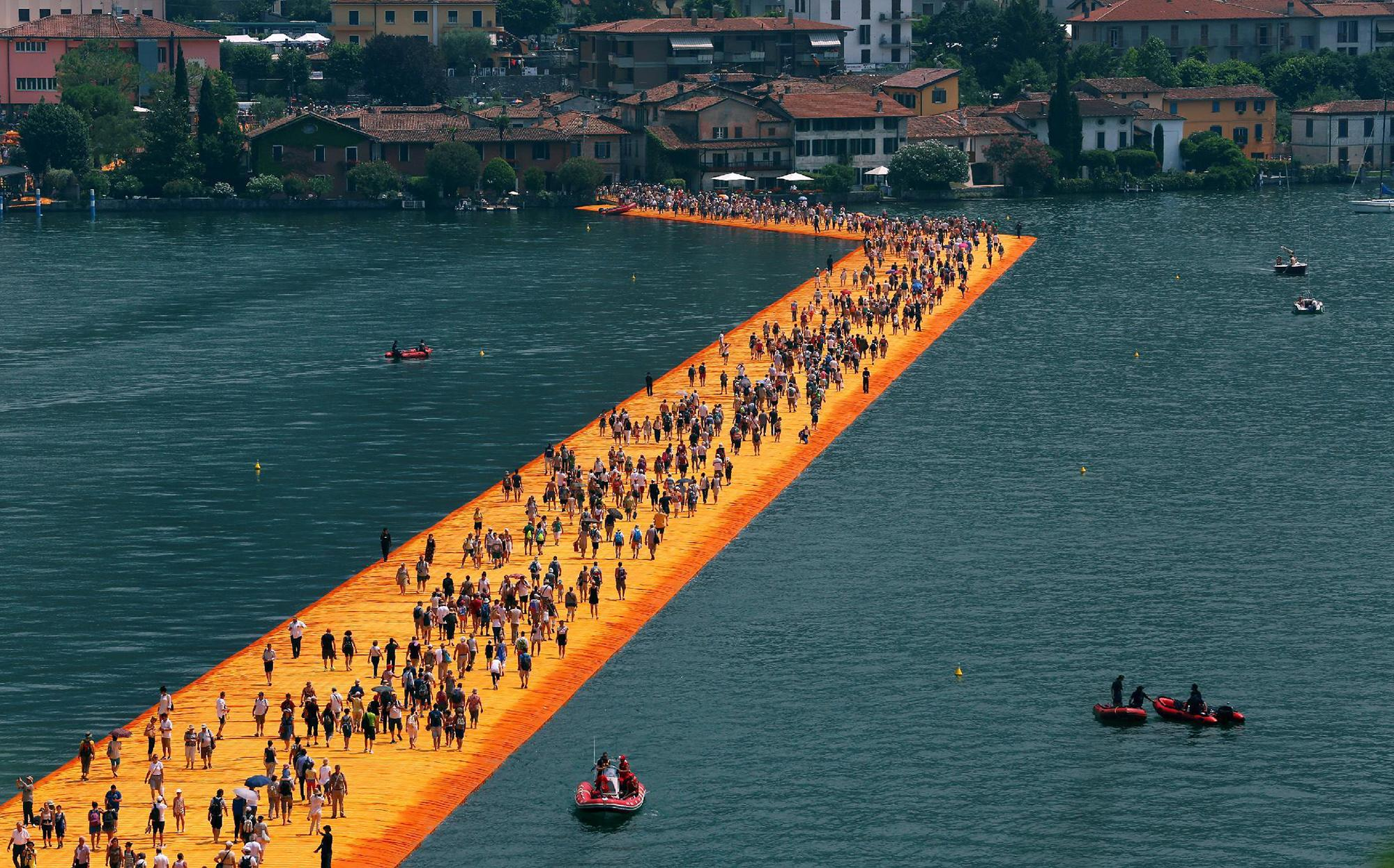 People walk on water at Italian lake 'Floating Piers' installation