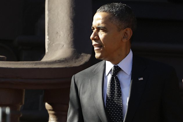 President Barack Obama walks from Blair House across Pennsylvania Avenue as he returns to the White House in Washington, Thursday, Dec. 13, 2012, after attending a holiday party for the National Security Council. (AP Photo/Charles Dharapak)