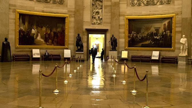 A man walks through a nearly empty Capitol Rotunda during the late hours of a continuing budget battle on Capitol Hill on Monday, Sept. 30, 2013 in Washington. The Republican-controlled House and the Democrat-controlled Senate are at an impasse as Congress continues to struggle over how to prevent a possible shutdown of the federal government when it runs out of money. (AP Photo/Evan Vucci)