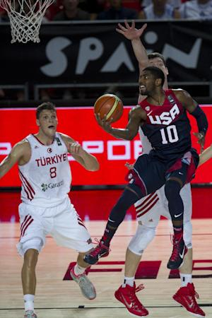 United States's Kyrie Irving, right, goes for the basket in front Turkey's Baris Hersek, left, during the Group C Basketball World Cup match, in Bilbao northern Spain, Sunday, Aug. 31, 2014. The 2014 Basketball World Cup competition take place in various cities in Spain from last Aug. 30 through to Sept. 14. (AP Photo/Alvaro Barrientos)