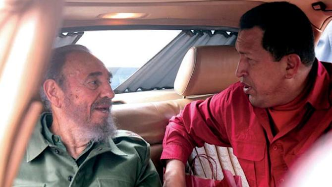 """FILE - In this July 22, 2006 file photo released by Miraflores Press Office, Venezuela's President Hugo Chavez , right, speak with Cuba's Fidel Castro during their visit to the home of Cuban revolutionary Ernesto """"Che"""" Guevara in Cordoba, Argentina. (AP Photo/Miraflores Press Office, File)"""