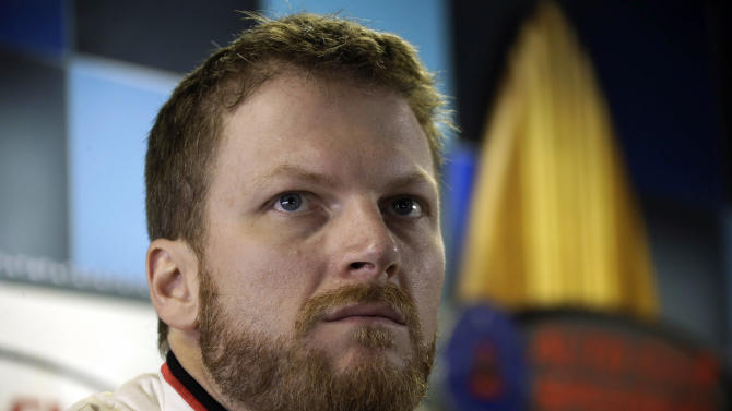 Dale Earnhardt Jr. speaks to reporters after practice for the NASCAR Sprint Cup series auto race in Fontana, Calif., Friday, March 22, 2013. (AP Photo/Reed Saxon)