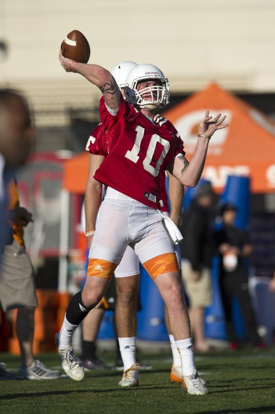 Tennessee quarterback Riley Ferguson passes during the NCAA college football team's first spring practice of the season, Friday, March 7, 2014, in Knoxville, Tenn