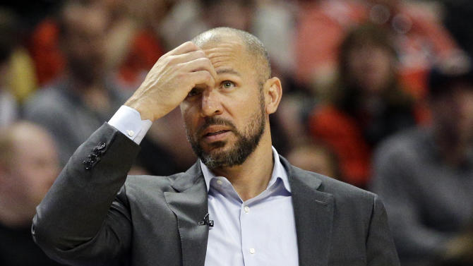 Milwaukee Bucks head coach Jason Kidd checks the scoreboard during the second half in Game 1 of the NBA basketball playoffs against the Chicago Bulls, Saturday, April 18, 2015, in Chicago. (AP Photo/Nam Y. Huh)