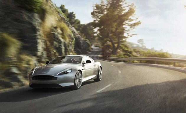 Aston Martin DB9: Grand touring, in the grandest of manner, is what Aston Martins two-plus-two DB9 does best. The extra space of those two kiddy seats means room to toss a couple of coats or bags. 